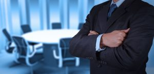 generic businessman in generic conference room representing 'the man'